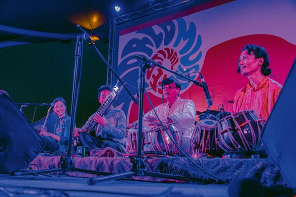 With frequent cultural interaction, musical styles gradually blend together. Seen here are the group Coromandel Express and Indian tabla master Dilip Mukherjee.