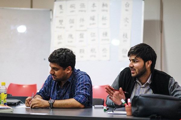 Class snapshot: Indian students engaged in lively discussion.