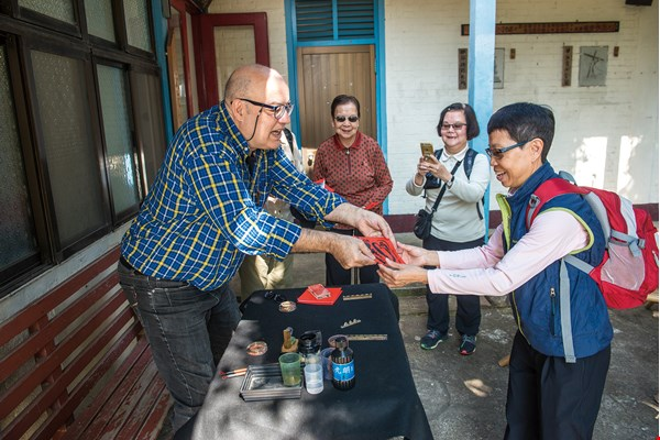 "Visitors who have come all the way from Hong Kong specially to visit the Jingliao Holy Cross Church leave with a sample of Verny's original ""French-style New Year's couplets."""