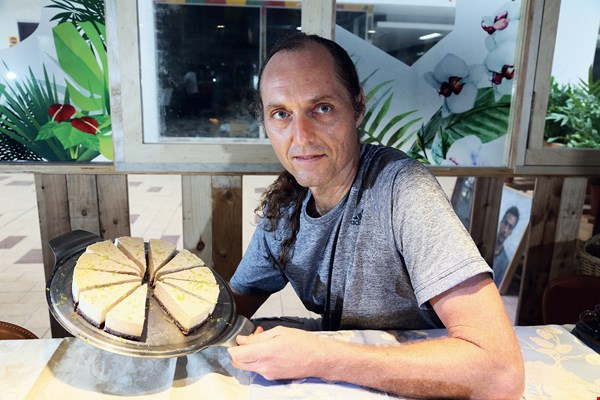 Andrew Nicholls with his tasty vegan cheese pie—sans milk or eggs.