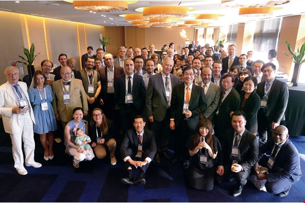 "The ""Fu-Chan Wei Club"" holds a happy gathering after the 2017 Congress of the World Society for Reconstructive Microsurgery. (courtesy of the Plastic Surgery Department, CGMH)"