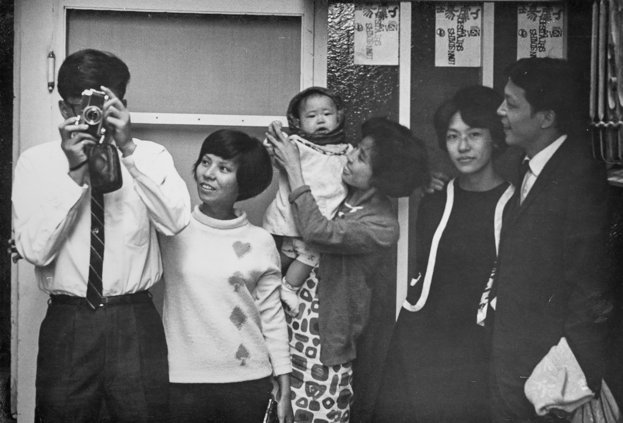 Some of the editors of Theater Quarterly gathering at the house of Chiu Kang-chien: Chiu himself (first left), Chen Xiasheng (center, holding child), and Huang Hua-cheng (first right). (courtesy of Chuang Ling)