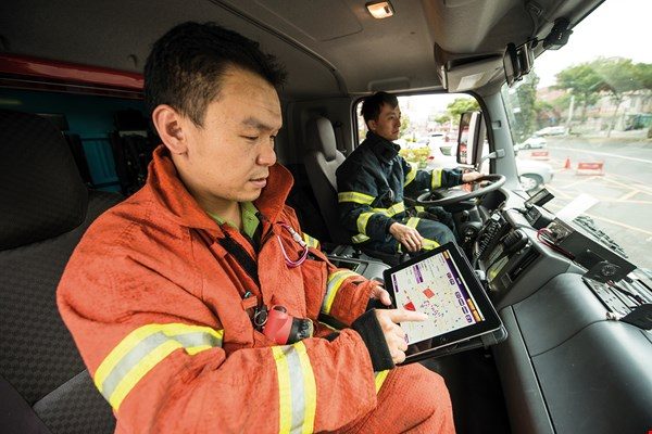 Firefighters use a smart mobile dispatch system to plan their emergency responses and check traffic information along their routes.