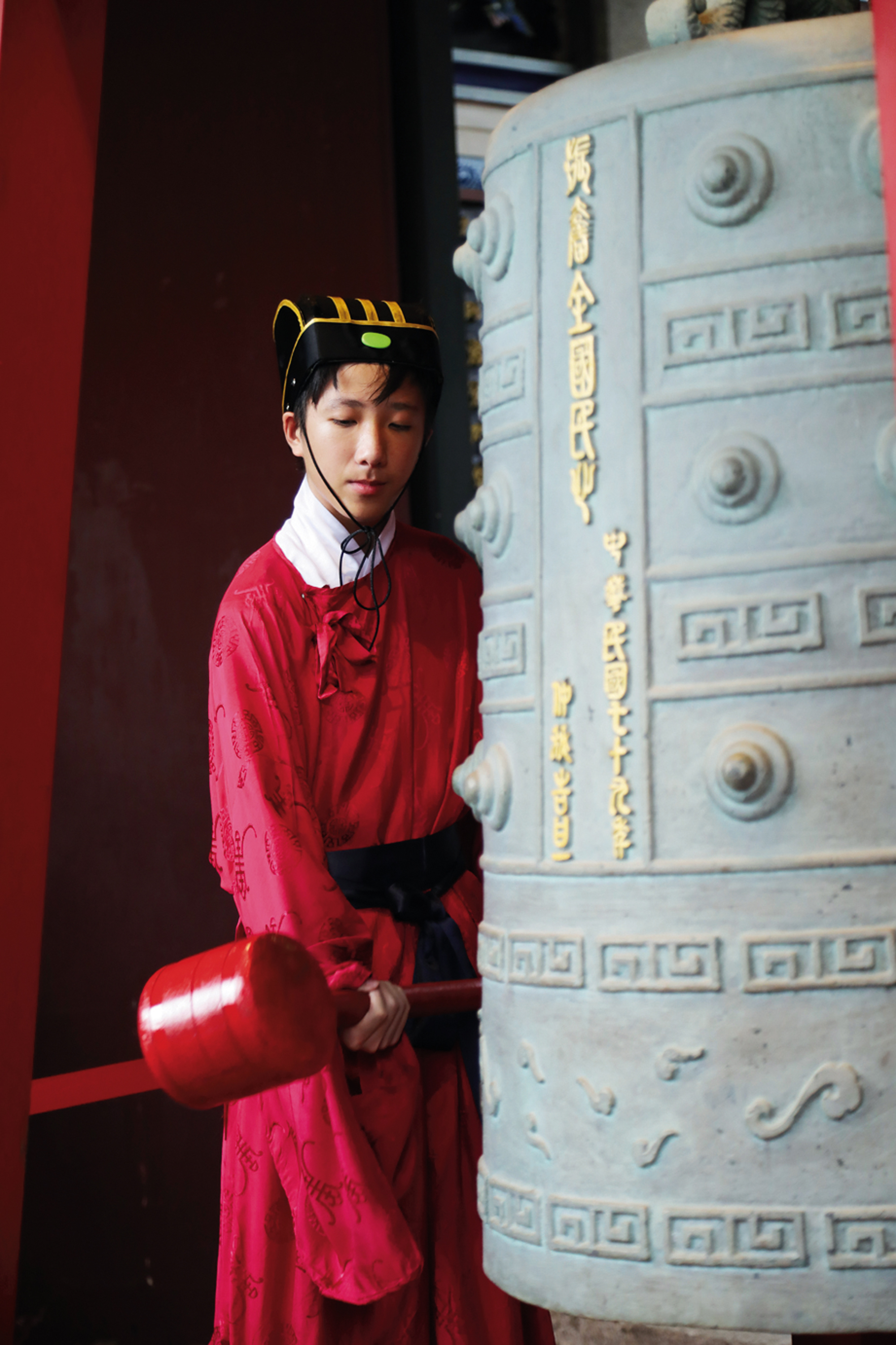 The red-gowned musicians practice over the course of a full year before their performance. In recent years they have all come from Taipei's Chongqing Junior High School.