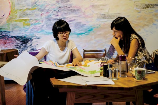 Happen's founders, Chiu Chia-yuan (right) and Chang Pei-chi (left), operate their coworking space as a social enterprise.