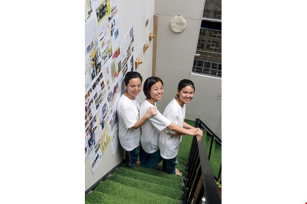 Wang Guofang and her two daughters, Xingyi (center) and Pinjie (right) run their business, Wang's Culinary Delight, from Happen, and are grateful for all the help they have received.