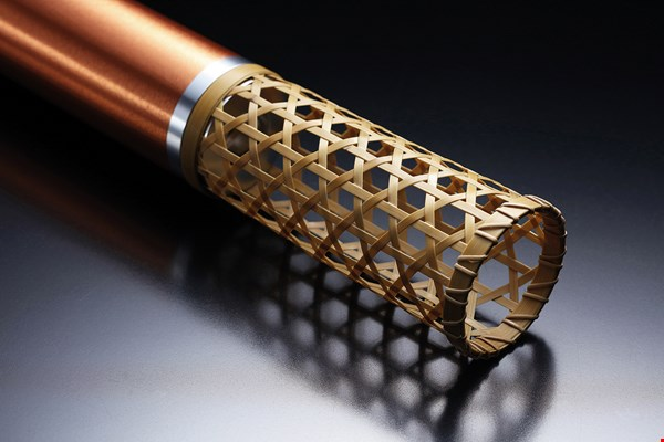 The bamboo work on the base of the torch was done by Nantou craftsman Su Su-jen, who employed a traditional hexagonal woven design. (courtesy of UID Create)