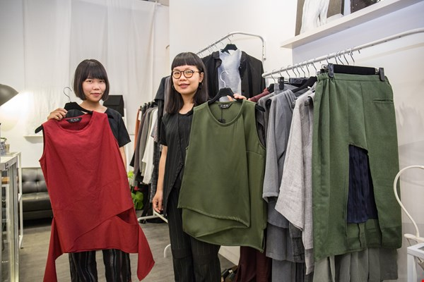 """I didn't use to be confident in myself, but my personality changed after I started wearing clothes I'd designed myself,"" says Yang Yun Han (left), who encourages conservative customers to give them a try."