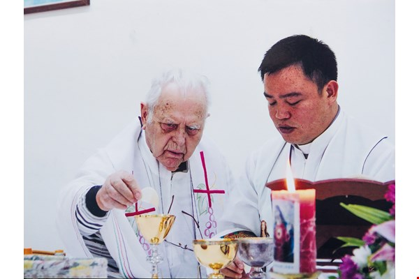 Poinsot has passed along his parish duties to Lin Xingliang (right), who continues to live out his predecessor's ideals of service to the community. (courtesy of You Wenxiong)
