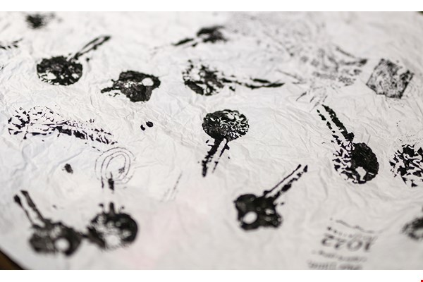 Designer Vansler Huang used stone rubbing techniques to create mottled images of keys on white paper, symbolizing the process by which the disparate fragments of the tale fit together to complete the puzzle.
