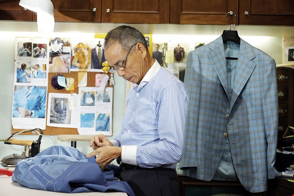 A custom suit puts the emphasis on work by hand. With more than 40 years of experience, master tailor Mr. Zheng still sews tight, neat stitches.