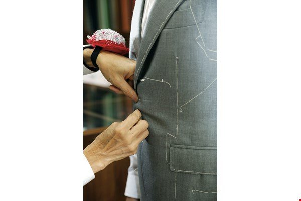 Taking the client's measurements and carrying out basted fittings are important steps in the process of making a bespoke suit.