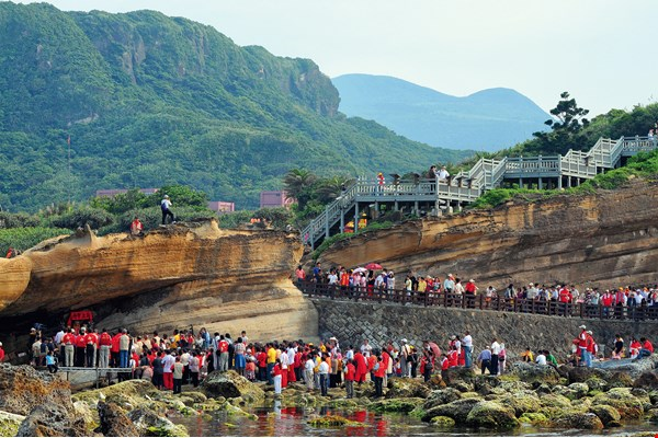"Mazu's Homecoming: Each year on the 16th day of the fourth lunar month a celebration is held at Yehliu Geopark's Mazu Cave to mark the return of Mazu from Cihu Temple in nearby Jinshan to her ""ancestral home."" (courtesy of Vasai Fishing Village Cultural Association)"