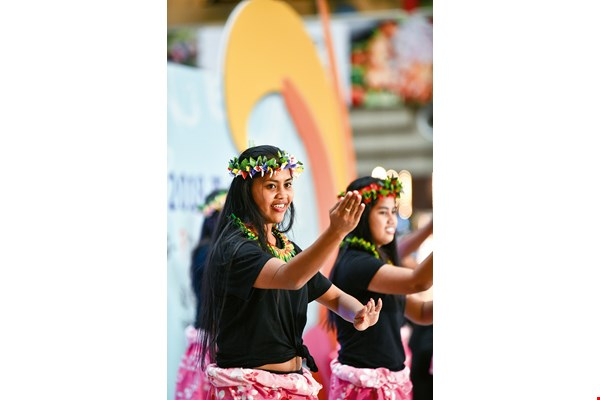 In the Te Mwaie traditional dance of Kiribati, dancers extend their arms outward like birds spreading their wings.