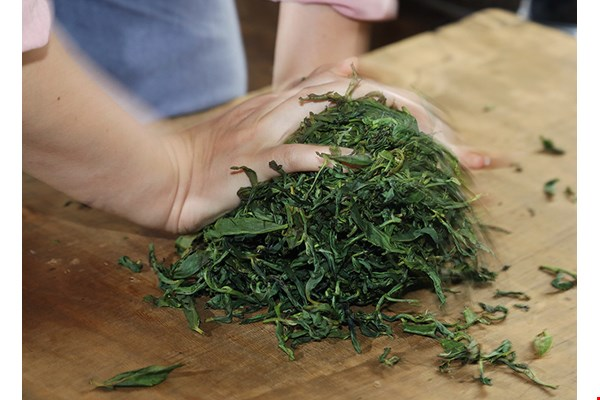 Pan-roasting tea, and rolling the leaves by hand between roasts, changes the fragrance and shape of the tealeaves, giving the tea a greater depth of flavor.