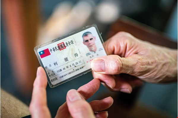 Kenrick's Taiwanese identity card is a testament to his contributions to rural medical care in Taiwan.