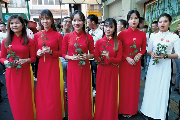 A group of female Vietnamese churchgoers in traditional ao dai.