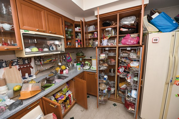 Before the reorganization, the client had too many things in her kitchen, and they were messily arranged.