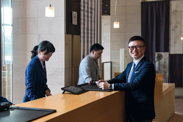 Winston Shen, CEO of Hotel Royal Group, still takes time to get in amongst the frontline service staff and interact with guests to better understand their needs.