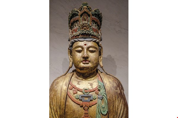 A painted wooden Buddhist statue from the Jin Dynasty (1115–1234 CE).